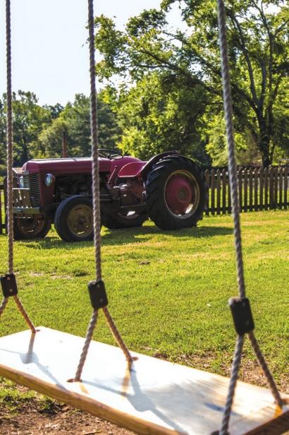 Swing and farm tractor - an idyllic country farm setting